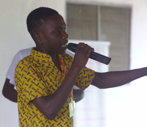 A person speaking trough a microphone
